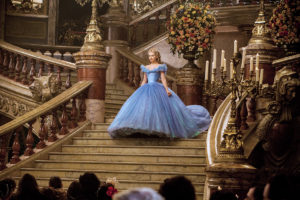 Lily James is Cinderella in CINDERELLA , a live-action feature which brings to life the timeless images from Disney's 1950 animated masterpiece as fully-realized characters in a visually dazzling spectacle for a whole new generaton.